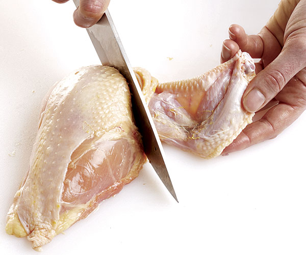 cutting up a chicken step 8