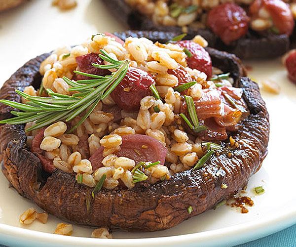 Farro with Balsamic-Rosemary–Roasted Shallots and Grapes over Roasted Portobellos