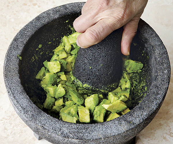 Use the pestle or a fork to scrape the paste off the bottom of the mortar as you mix it with the avocados