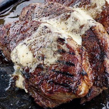Grilled Strip Steaks with Miso-Truffle Butter
